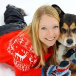 Woman Hugging German Shepherd Husky Mix Dog in Snow