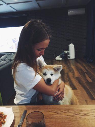 Alexandra Seagal with a akita inu dog