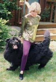 Canine Freestyle - Woman dancing with newfoundland dog